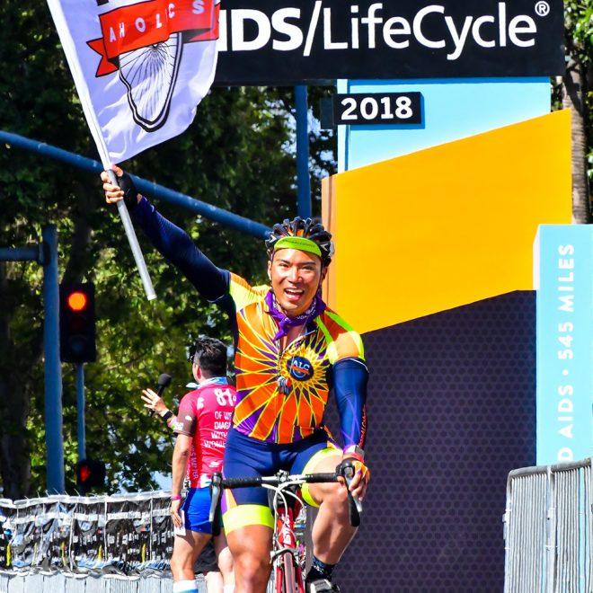 2018 ALCaholics team leader crossing the finish line in LA